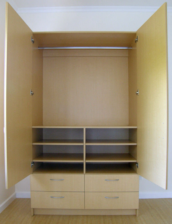 Stand alone wardrobe with shelves and drawers